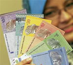 Should Malaysia Save More or Less?